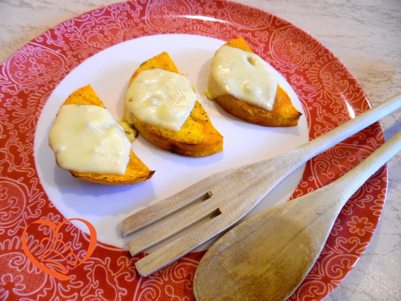Spicchi di zucca con formaggio al forno